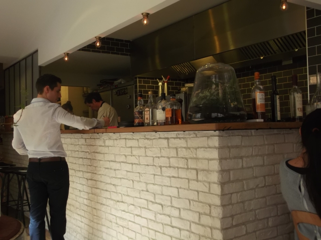 Chef and his staff work in a small, open kitchen.