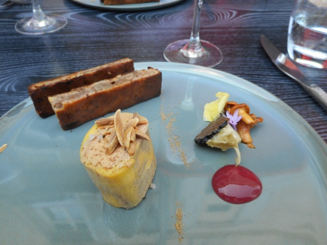 A delicious garnished serving of foie gras.
