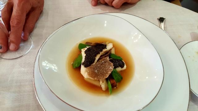 Delicate fish in a delicious broth.