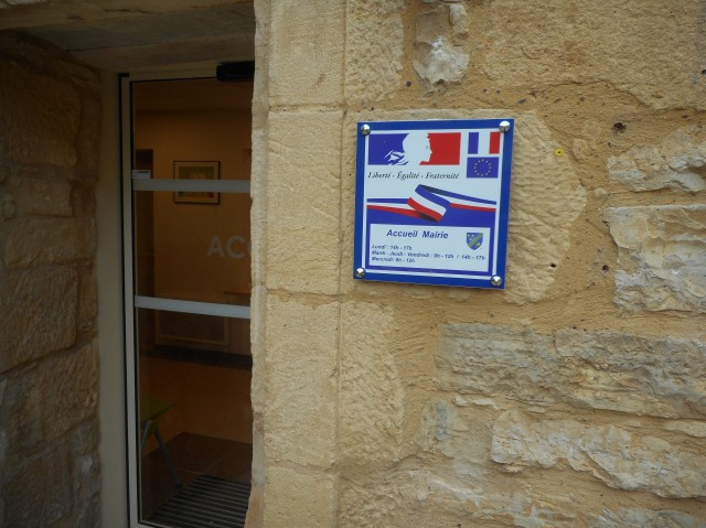 """""""Welcome"""" says the door (in French, of course)."""