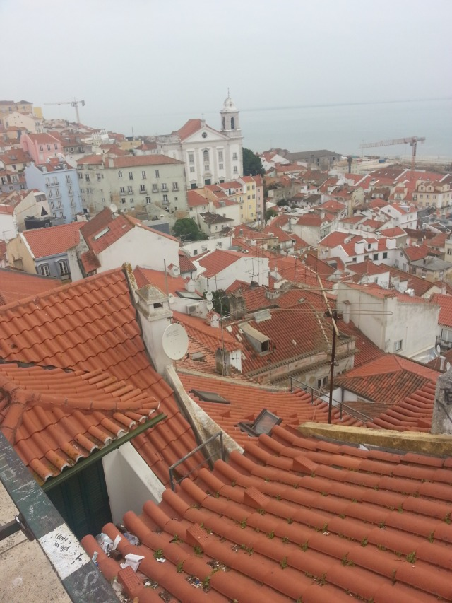 Looking down on Lisbon's tiled roofs.